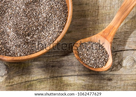 Chia seeds in wooden bowl and spoon #1062477629