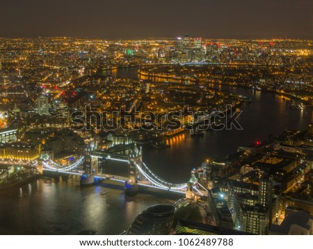 Aerial night view of London and Tower Bridge #1062489788
