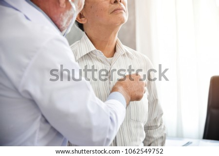 Senior Doctor is examining Asian patient with stethoscope in the hospital. Medical and health care concepts. Lung, Cancer, pneumonia. Royalty-Free Stock Photo #1062549752