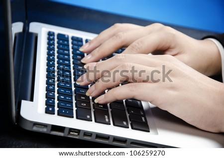 human hand pressing on computer keyboard #106259270