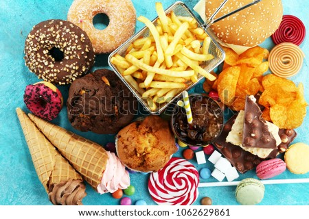 Unhealthy products. food bad for figure, skin, heart and teeth. Assortment of fast carbohydrates food.  #1062629861