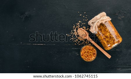 Grain Mustard. Spices On a dark wooden background. Top view. Copy space for your text. #1062745115