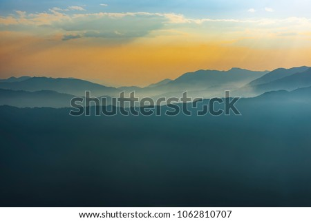 Blue Colourful Mountains Layers in Sunset Sky, Annapurna range , Nepal. #1062810707