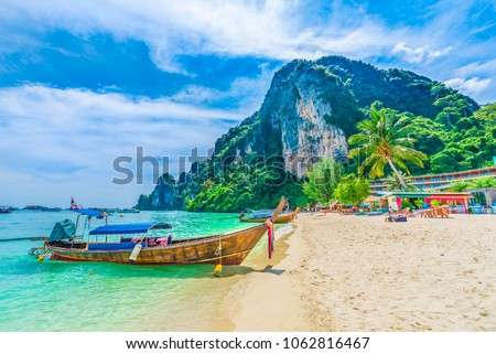 Tonsai Beach bay with traditional longtail boats parking in Phi Phi island, Krabi Province, Andaman Sea,  Thailand Royalty-Free Stock Photo #1062816467