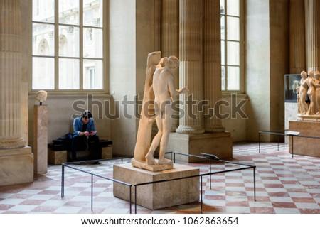 PARIS - APRIL 2, 2018: Statue in the Pavillon de lâ??Horloge (Clock Pavilion) of the Louvre, the world's largest art museum and a historic monument in Paris, France #1062863654