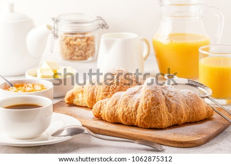 Continental breakfast with fresh croissants, orange juice and coffee, selective focuse. #1062875312
