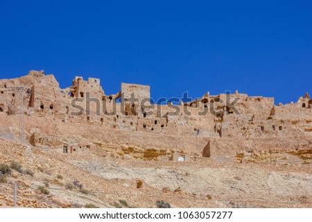 Berber village in the sandstone mountain in the Sahara, Africa  #1063057277