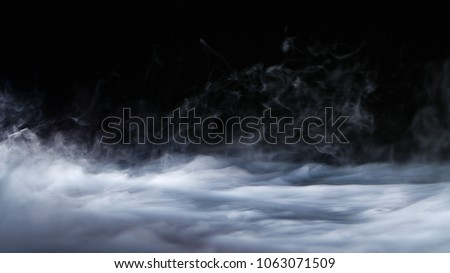 Realistic dry ice smoke clouds fog overlay perfect for compositing into your shots. Simply drop it in and change its blending mode to screen or add. Royalty-Free Stock Photo #1063071509