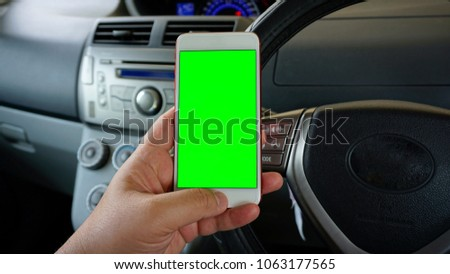 Man holding the phone with green screen (chroma key). Open technology concept. #1063177565