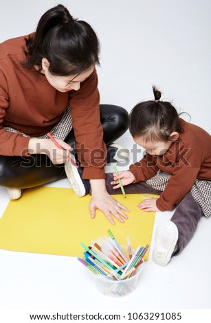 Cute Asian mother and daughter painting, studio shot #1063291085