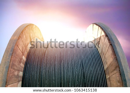 black wire electric cable on wooden under the sky background. #1063415138