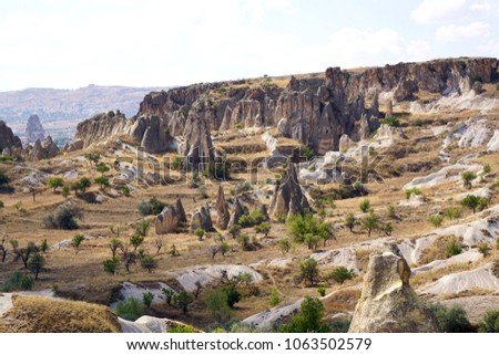 "Cappadocia, Kapadokya Otelleri, semi-arid region in central Turkey, is known for its distinctive ""fairy chimneys,"" tall, cone-shaped rock formations clustered in Monks Valley, Göreme, Turkey #1063502579"