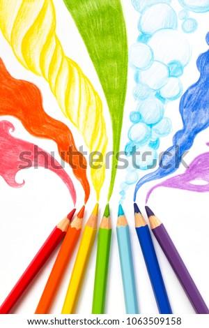 Pencils drawing rainbow smoke