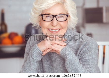 Closeup portrait of handsome blonde adult businesswoman toothy smile #1063659446