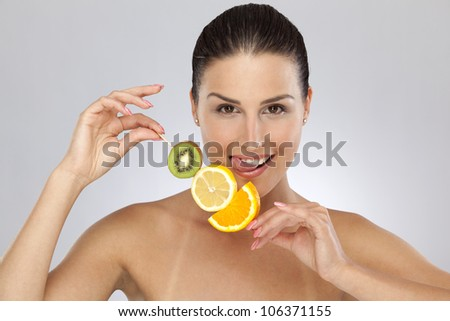 Woman with citrus fruits #106371155