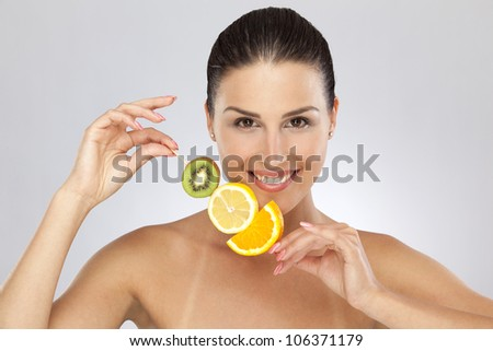 Woman with citrus fruits #106371179