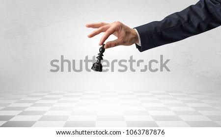 Big elegant hand taking his next step on chess game #1063787876