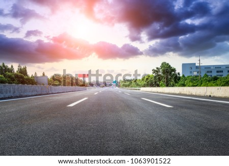 asphalt road and beautiful sky clouds at sunset #1063901522