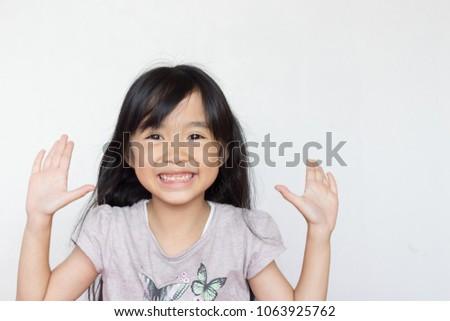 asian child play peekaboo on white background #1063925762