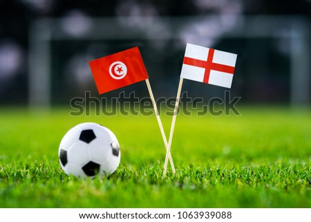 Tunisia - England, Group G, Monday, 18. June, Football, National Flags on green grass, white football ball on ground. #1063939088