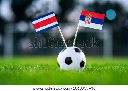 Costa Rica - Serbia, Group E, Sunday, 17. June, Football, World Cup, Russia 2018, National Flags on green grass, white football ball on ground. #1063939436