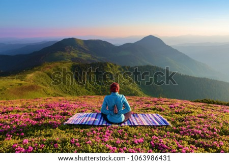 colorful carpet the yoga girl in the… stock photo