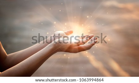 Woman hands praying for blessing from god on sunset background  #1063994864
