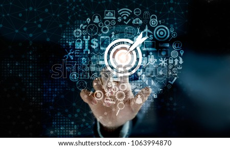 Digital marketing. Businessman touching darts aiming at the target center with icon network connection. Business goal and technology concept #1063994870