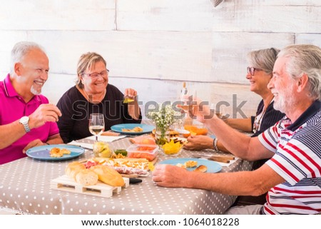 nice leisure time for group of two couples senior having lunch together with a lot of smile and laugh. friendship forever concept. #1064018228