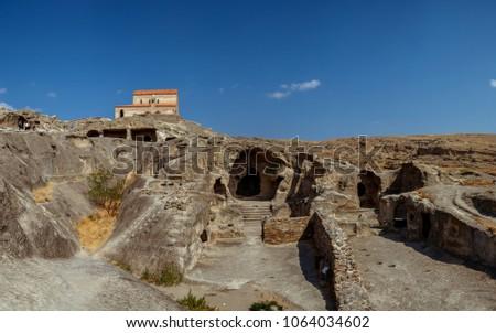 Uplistsikhe Is An Ancient Rock-hewn Town In Eastern Georgia. UNESCO World Heritage Site. Shida Kartli Region, Georgia. #1064034602