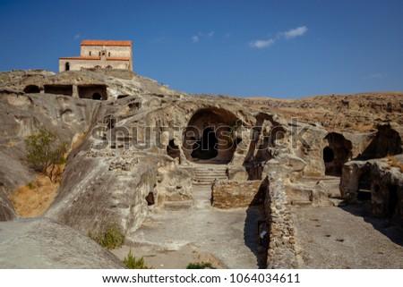Uplistsikhe Is An Ancient Rock-hewn Town In Eastern Georgia. UNESCO World Heritage Site. Shida Kartli Region, Georgia. #1064034611