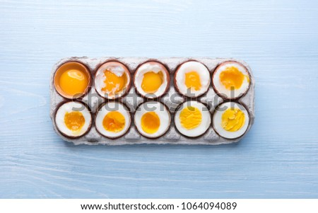 eggs in varying degrees of availability depending on the time of boiling eggs #1064094089