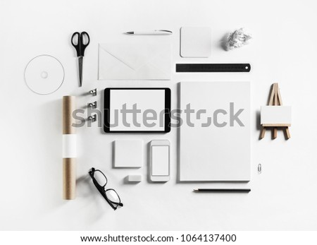 Blank corporate stationery and gadgets set on white paper background. Top view. Flat lay. #1064137400