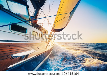 sailing into the sunset Royalty-Free Stock Photo #106416164