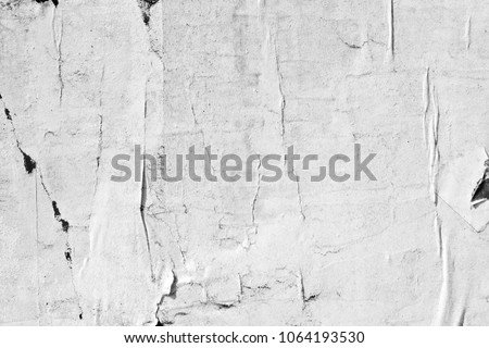 Old ripped torn grunge posters texture background creased crumpled blank paper backdrop placard surface empty blank space for text #1064193530