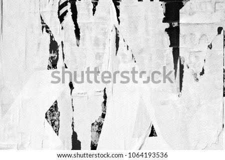 Old ripped torn grunge posters texture background creased crumpled blank paper backdrop surface empty blank placard space for text Royalty-Free Stock Photo #1064193536