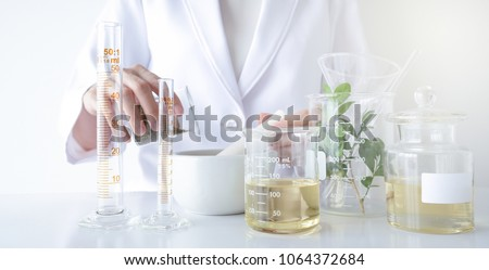 the scientist,doctor, make alternative herb medicine with herbal the organic natural in the laboratory. oil capsule, natural organic skincare and cosmetic. #1064372684