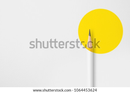 Presentation template with copy space by top view close up macro  photo of wooden yellow pencil put on texture white paper and combine with yellow circle shape.Flash light made soft light on pencil. #1064453624