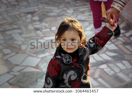 Ratia, Haryana, India – December 12, 2012: Cute little girl of Indian ethnicity standing portrait at home. #1064461457