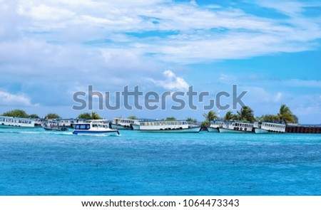 Panroamic view of boats moored at Male harbor, Maldive island on a sunny blue cloudy sky day holiday background #1064473343