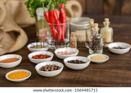 Various spices against a dark background. Food ingredients #1064485715