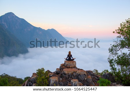 Serenity and yoga practicing at mountain range,meditation