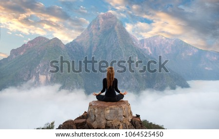 Serenity and yoga practicing at mountain range,meditation  #1064525450