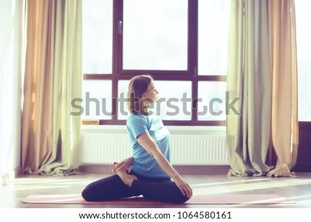 gymnastics training girl / gym girl doing gymnastics, stretching, healthy body, sports style training #1064580161