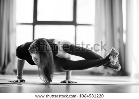 yoga girl sports hall / sport stretching, beautiful girl doing sports in the gym, yoga balance #1064581220