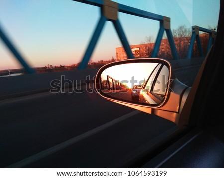 Rear view side mirror in car #1064593199