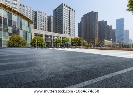 Empty Road with modern business office building   #1064674658