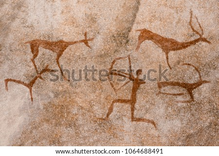 image of the ancient hunt on the wall of the cave ocher. historical art. archeology. Royalty-Free Stock Photo #1064688491