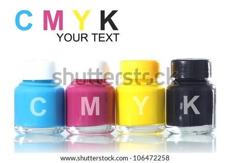 bottles of ink in cmyk colors