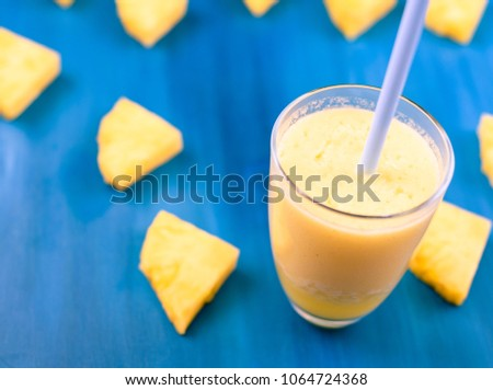 Fresh pineapple juice in the glass, selective focus #1064724368